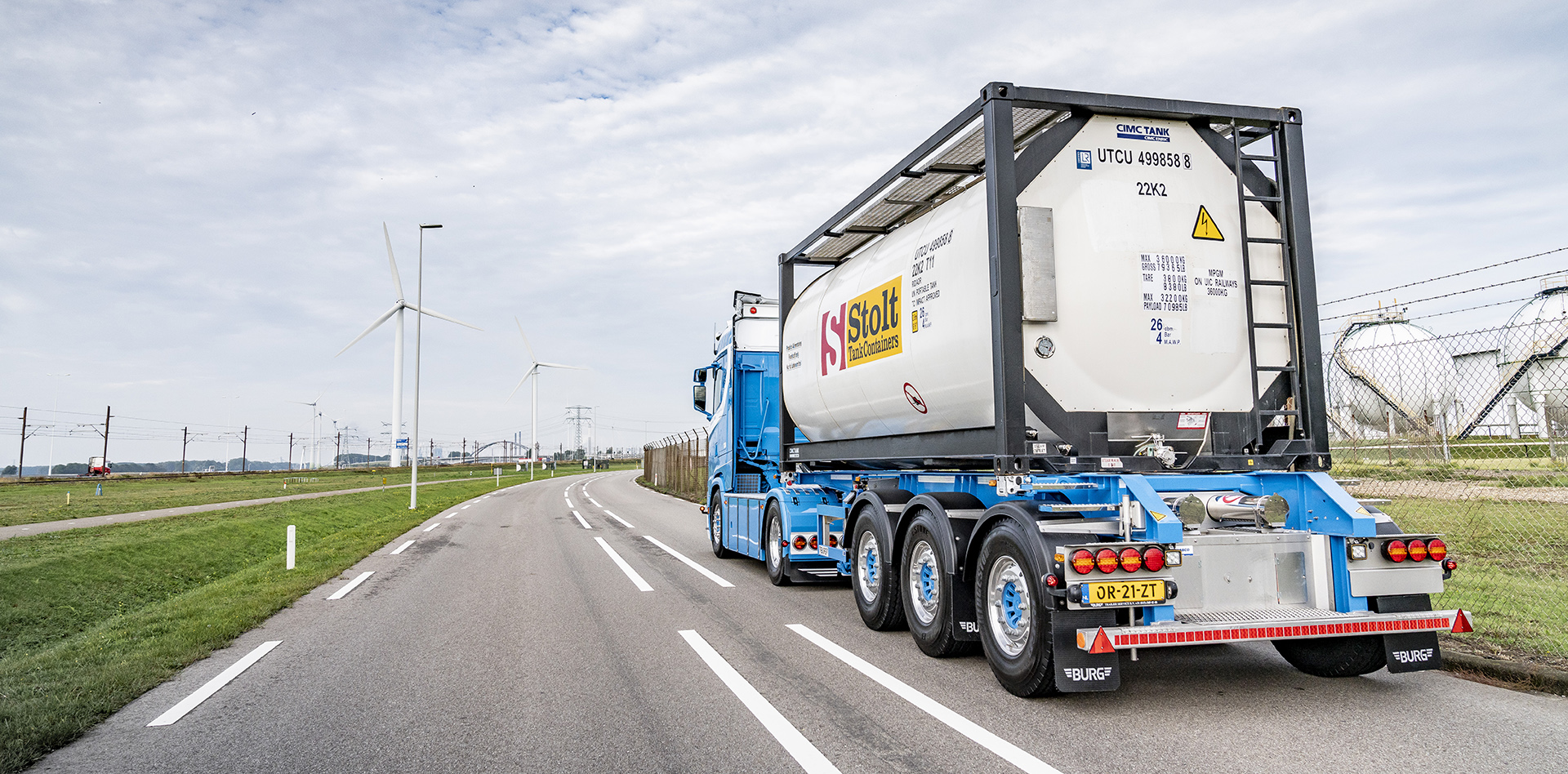 Truck driving with Stolt tank container in the industrial area